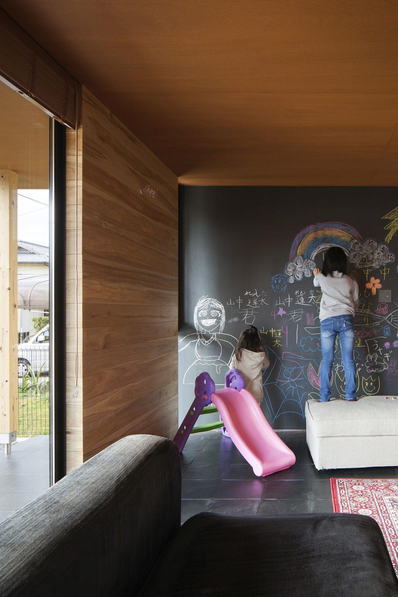 Fun kids' play area with chalkboard wall