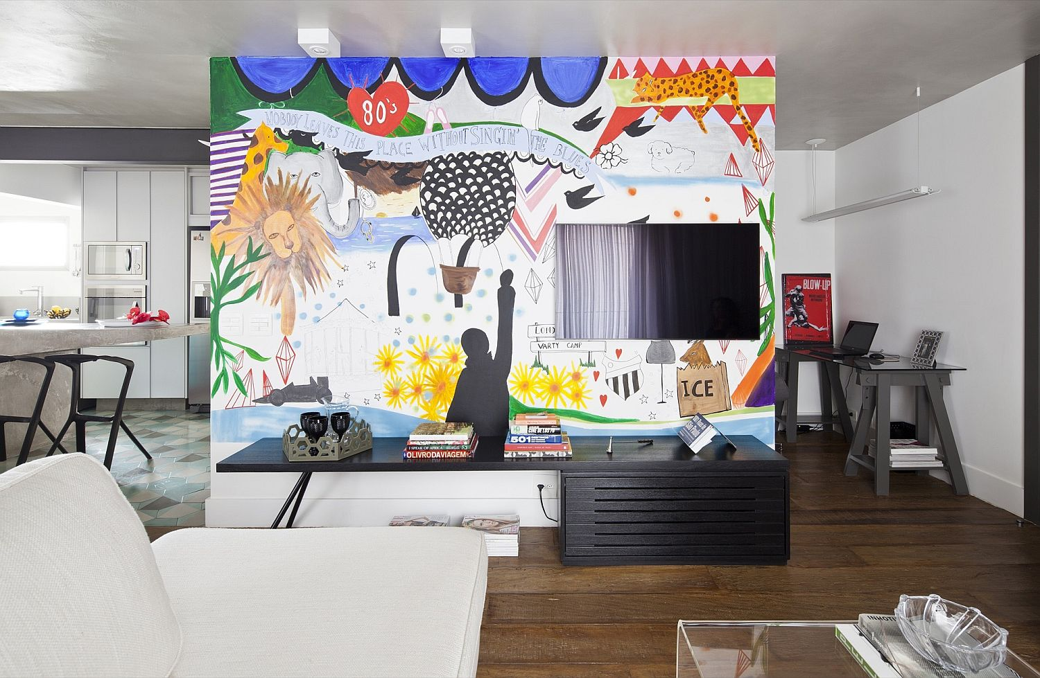 Graffiti wall becomes focal point of the bold modern living room