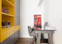 Home-office-with-gray-cabinets-along-with-bright-open-shelves-in-yellow-217x155