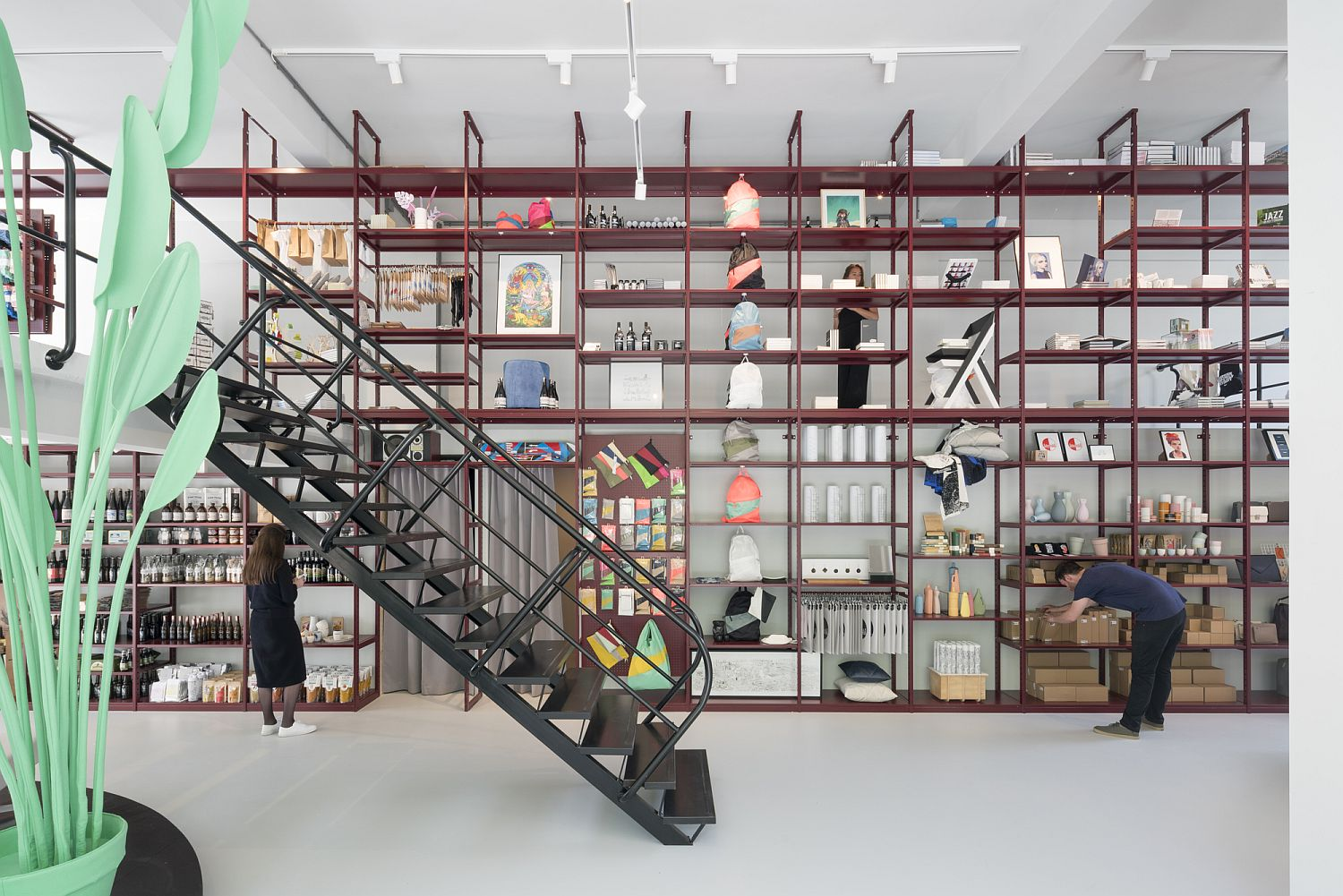 Industrial style sheling in red for the innovative Groos store Revitalized Interior of Groos: Creative Display Set in an Open Floor Space