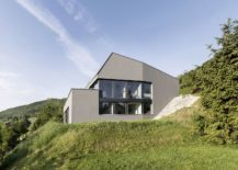 Irregular-rear-facade-of-the-house-along-with-a-unique-pitched-roof-217x155