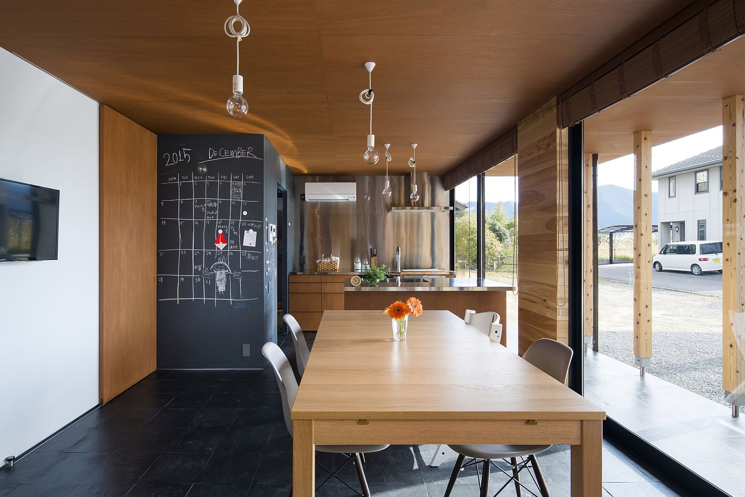 Kitchen and dining area of the Japanese home with cedar ceiling