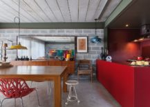 Kitchen-island-in-bright-red-along-with-bold-red-walls-217x155
