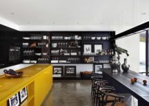 Kitchen-shelves-in-black-along-with-dark-dining-table-inside-the-LA-House-217x155