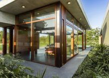 Large-glass-walls-and-sliding-doors-bring-the-outdoors-inside-217x155