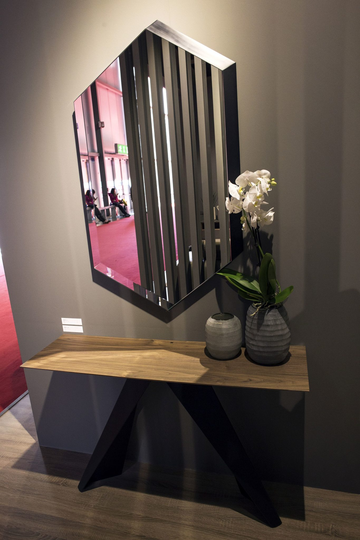 Large hexagonal mirror above a slim console for the entryway