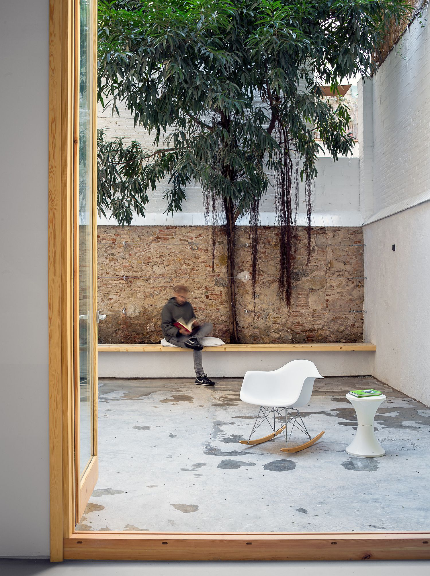 Large rear patio with tree becomes the hangout of the house