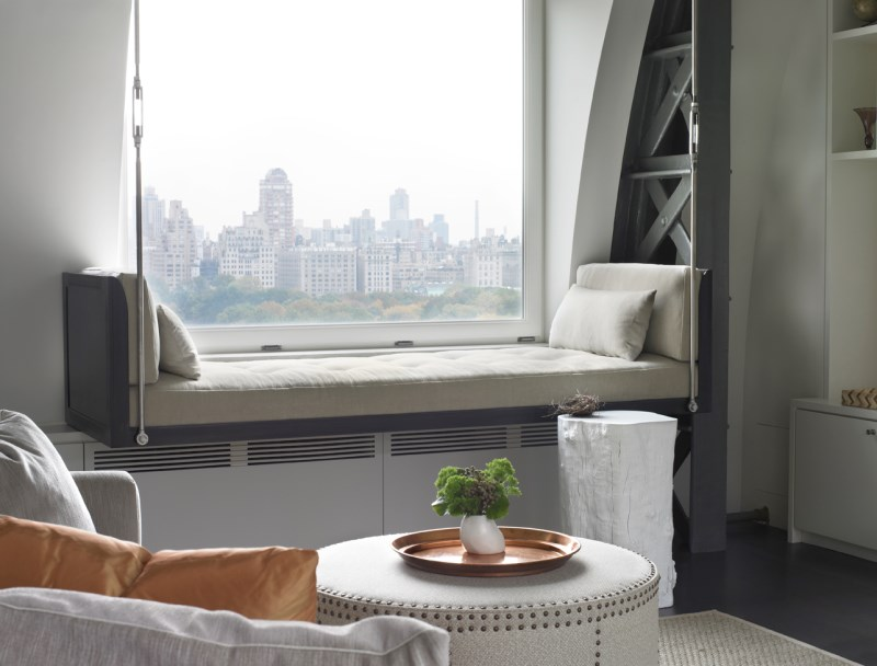 Lifted window seat as a one-of-a-kind interior element