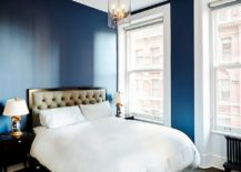 Light-filled-contemporary-bedroom-in-bold-blue-and-white-217x155