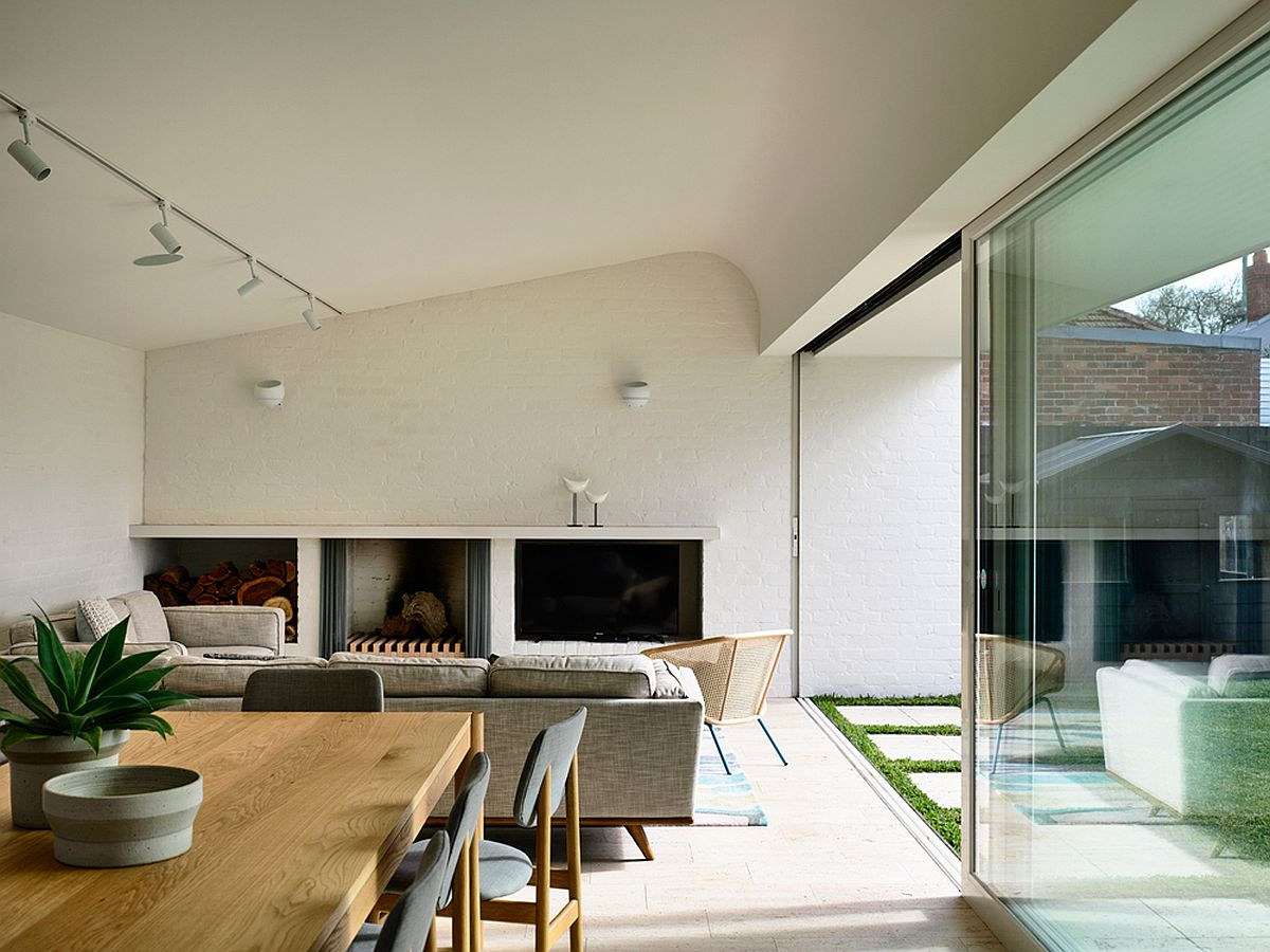 This post war house in melbourne gets a cheerful modern - Living room track lighting ...