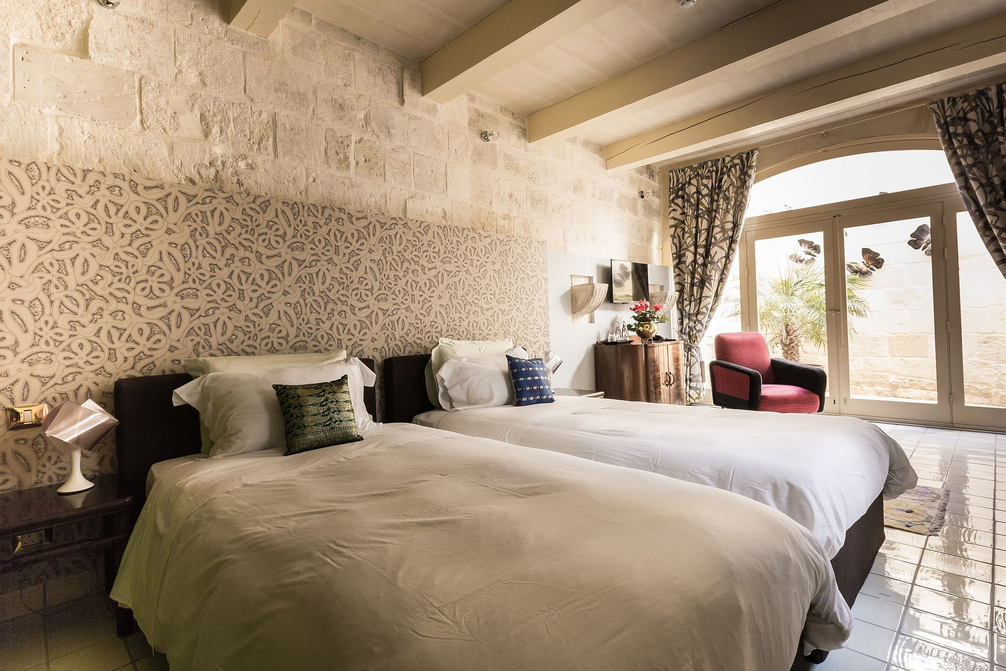 Lovely pattern and butterfly motifs dominate the third suite inside Locanda La Gelsomina