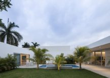 Lovely yard and pool connecting the different wings of the house 217x155 This Contemporary House in Yucatan is Designed for the Perfect Staycation!
