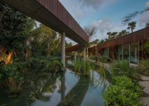 Man-made-lagoon-with-fishes-and-a-stunning-walkway-above-217x155