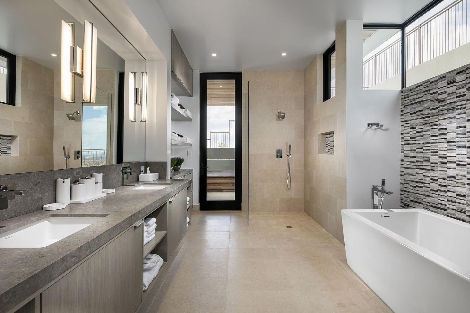 Master bathroom with white bathtub and vanity with ample storage