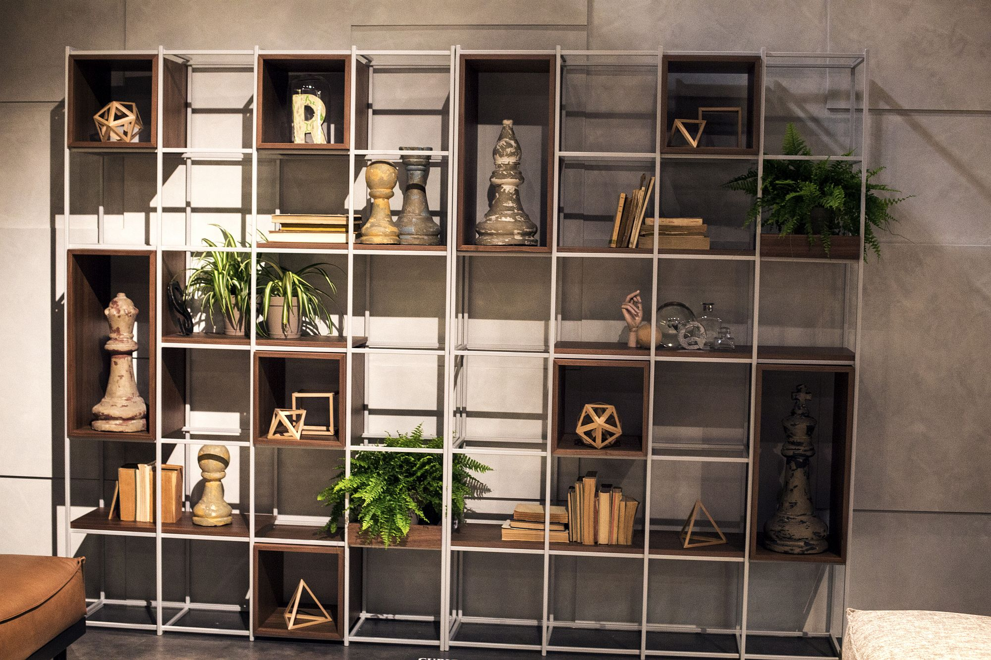 Metallic frame holds wooden boxes that create a cool display