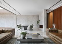 Minimal-appeal-of-the-dining-are-and-the-concrete-walls-complements-the-contemporary-style-of-the-living-room-217x155