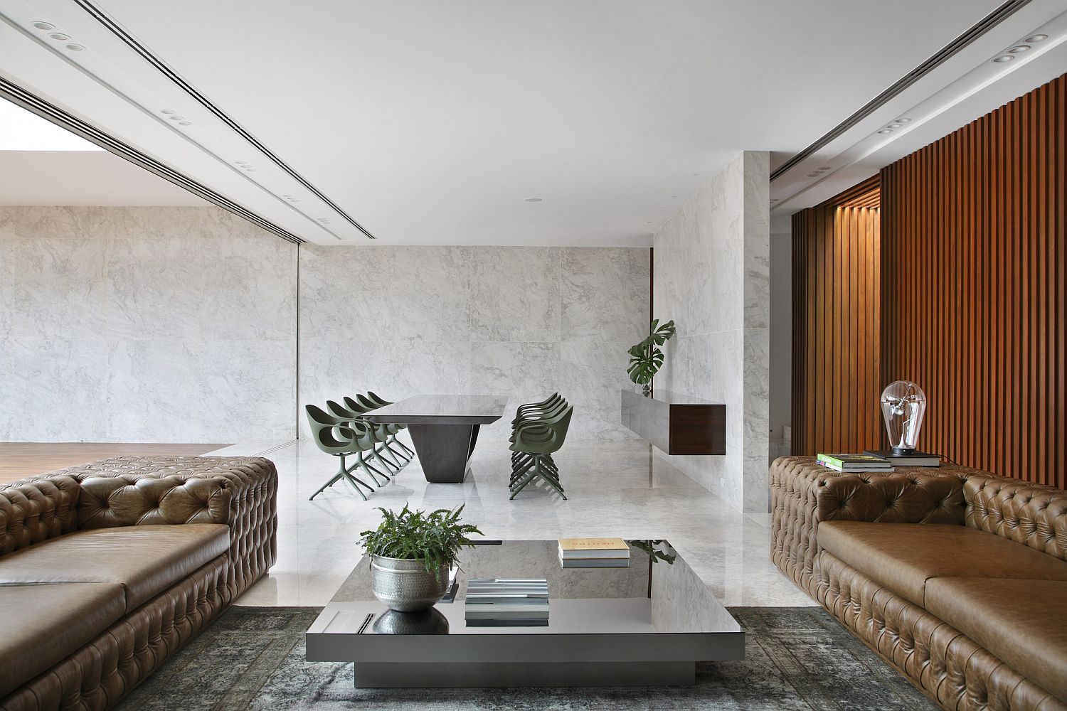 Minimal appeal of the dining are and the concrete walls complements the contemporary style of the living room