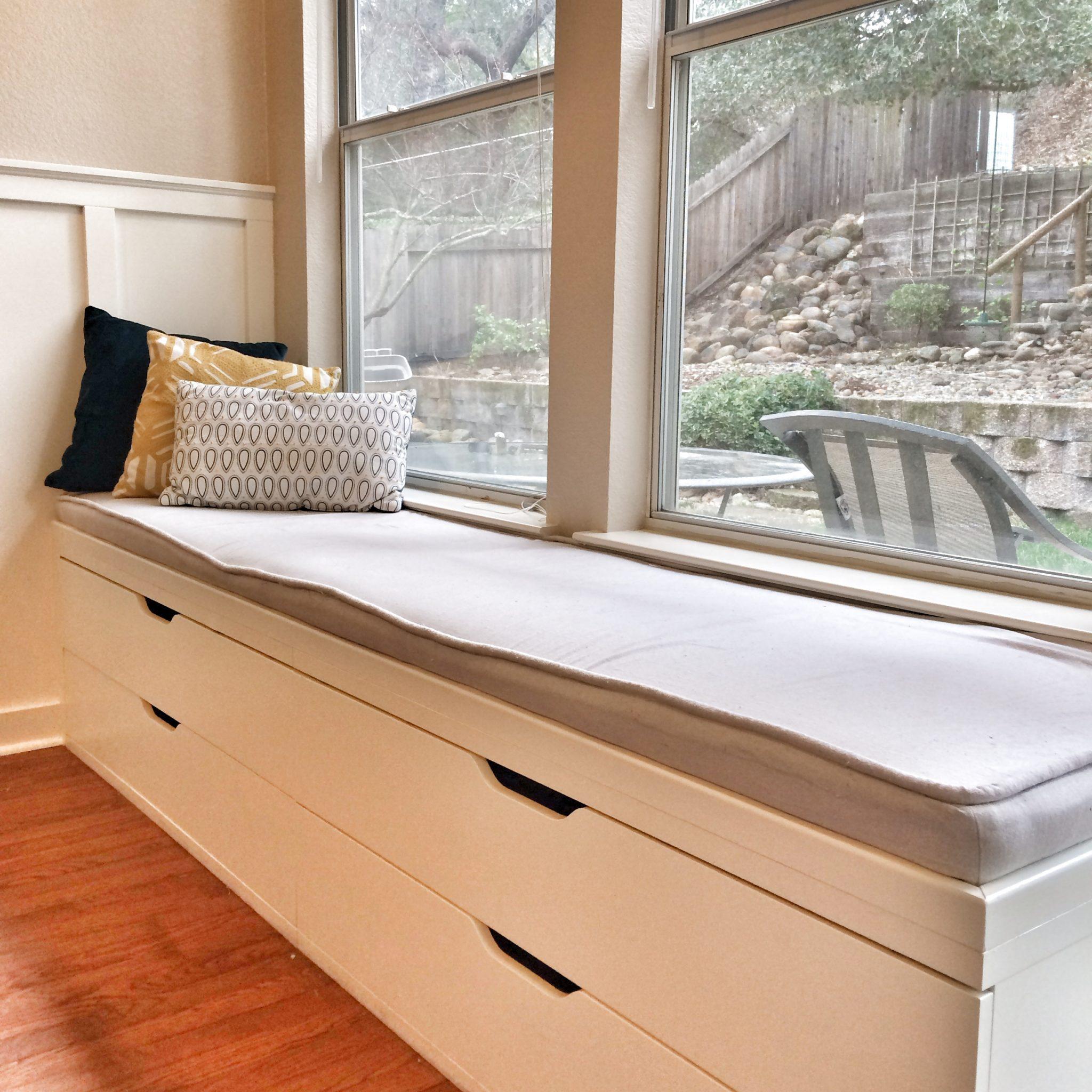 Minimalist window seat with gray cushioning