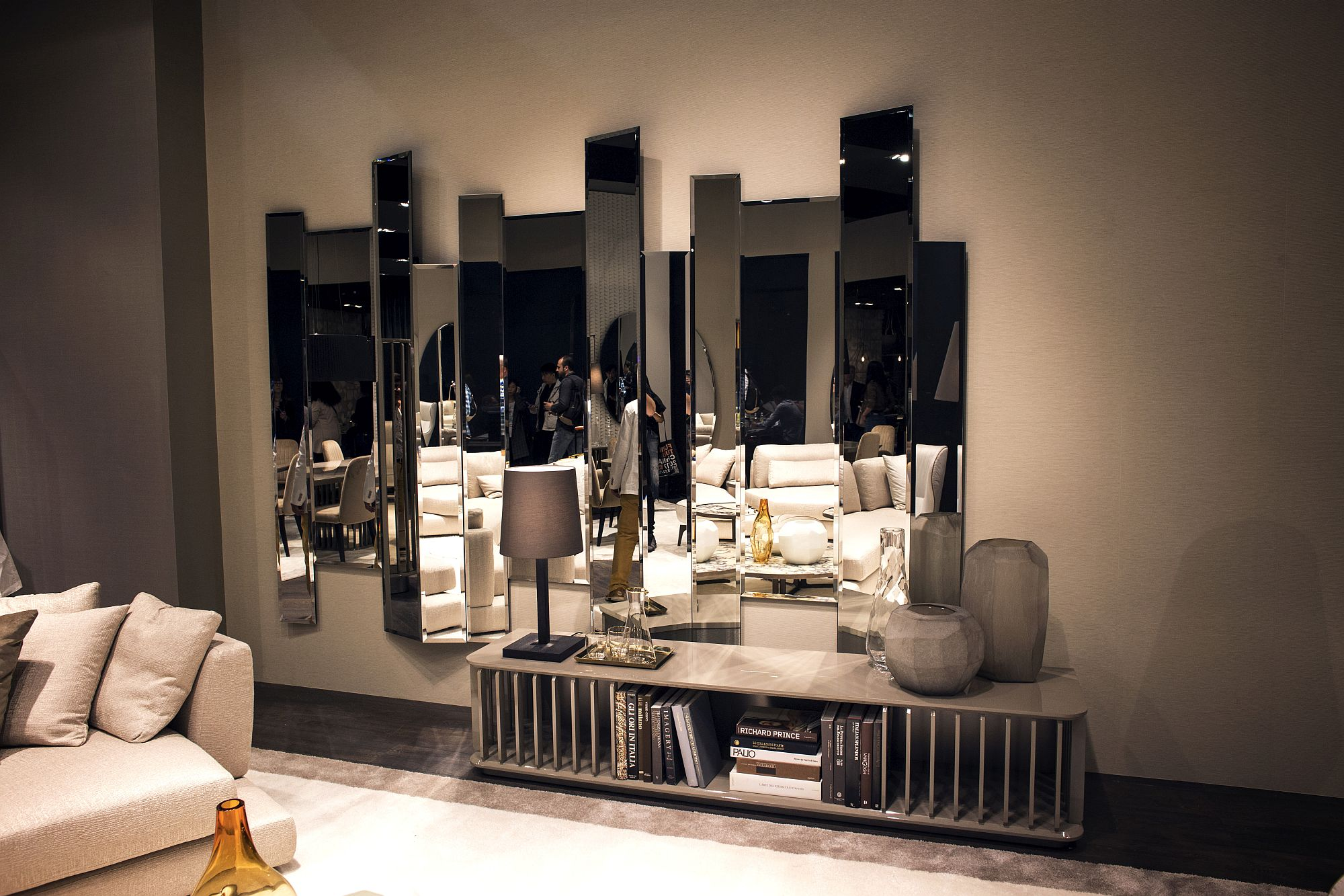 Modern and minimal mirror design creates a smart focal point in the living room