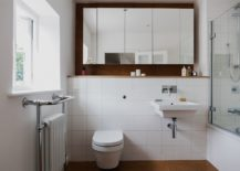 Modern-bathroom-in-white-with-white-tiles-and-cork-floor-217x155