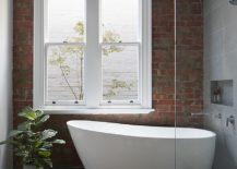 Modern-brick-wall-bathroom-with-standalone-bathtub-217x155