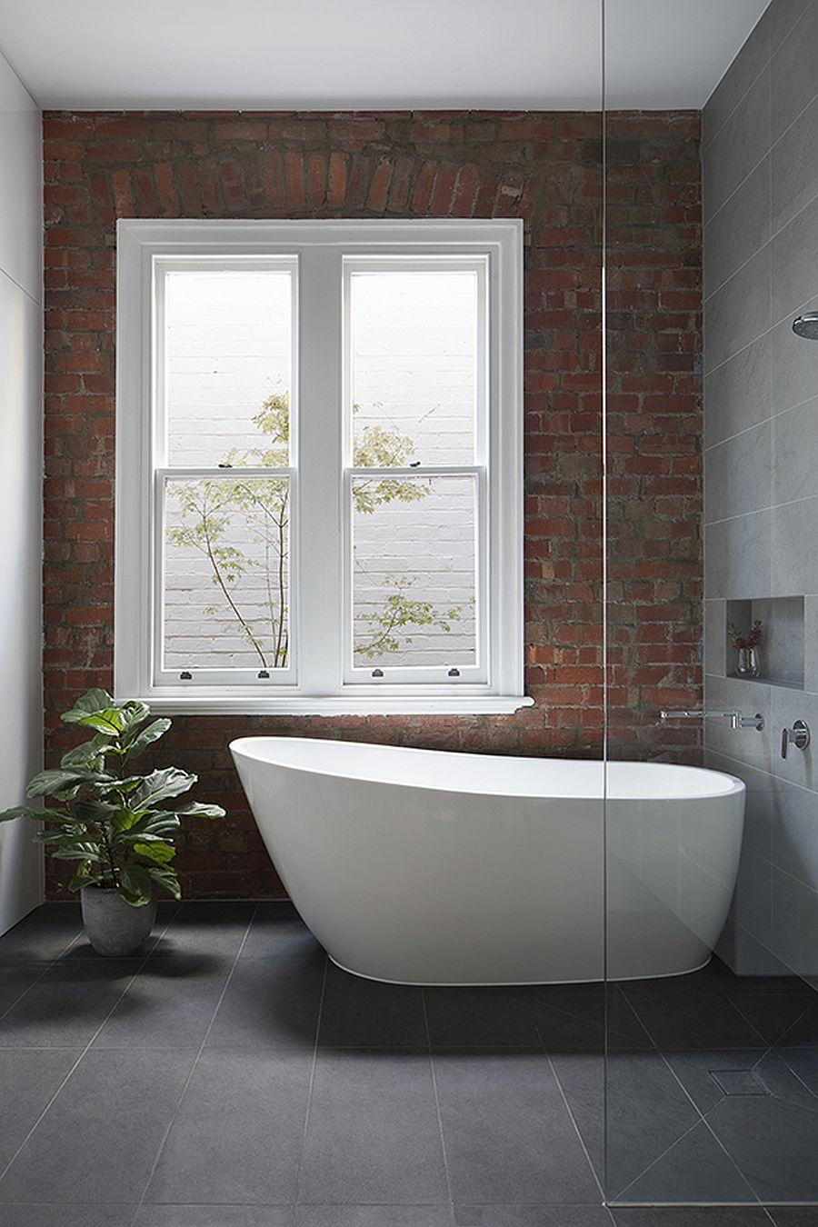 Modern brick wall bathroom with standalone bathtub
