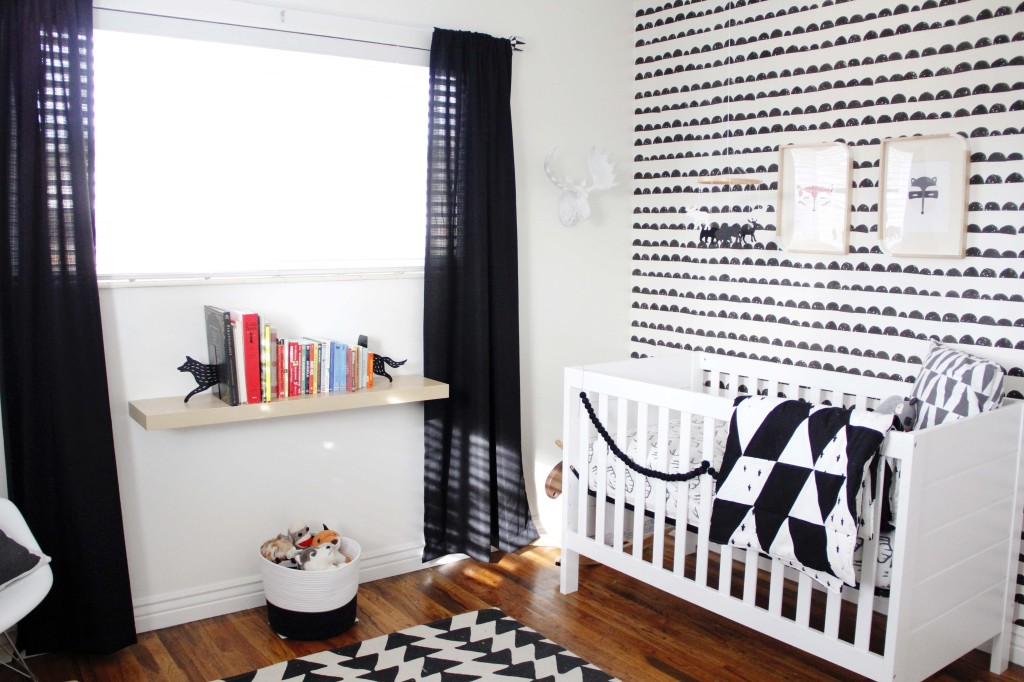 Monochrome nursery with black curtains
