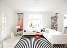 Monochrome-striped-rug-extending-through-the-bright-living-room-217x155