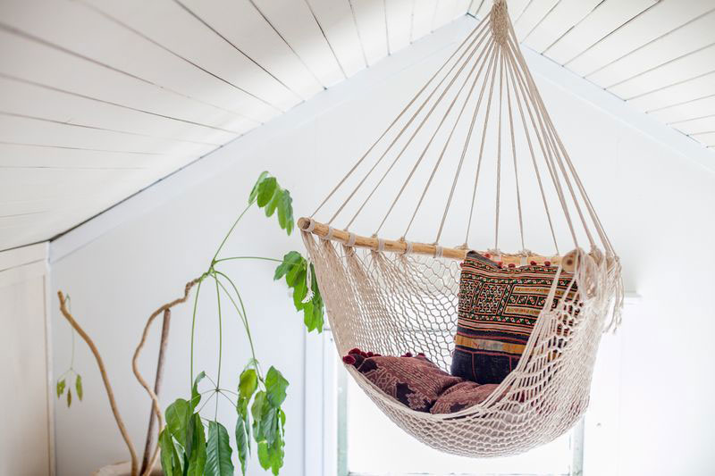 Net hammock chair with oriental cushions