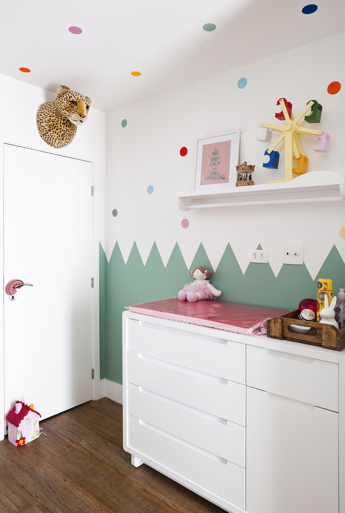 Nursery in white with colorful wall decal