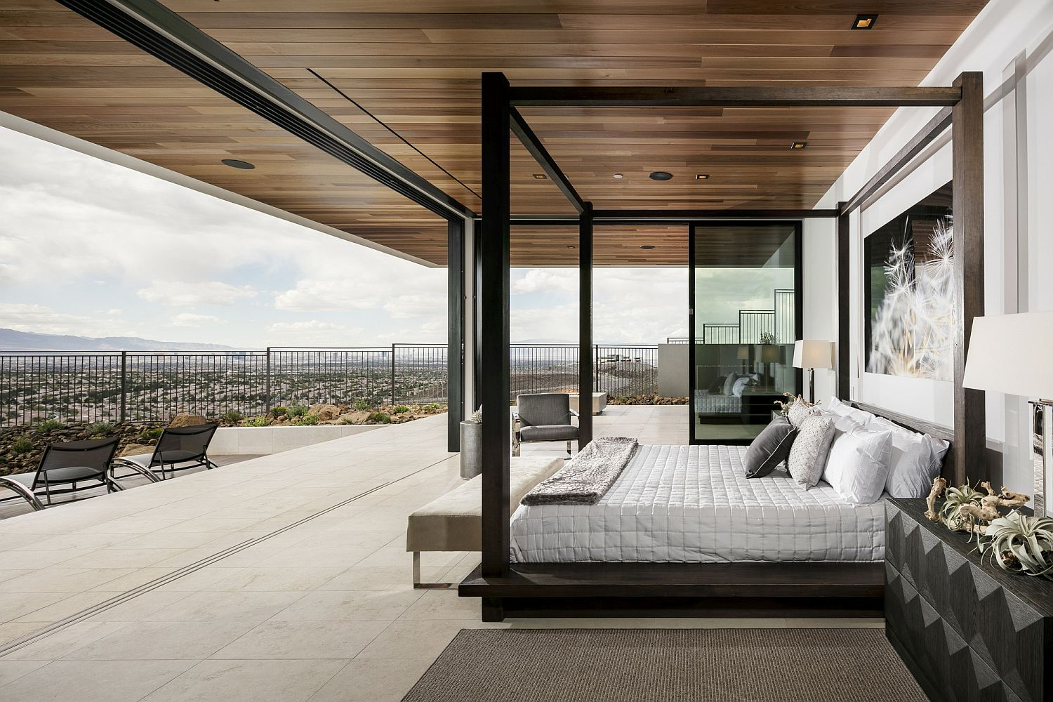 Open master bedroom design with stunning view of desert and Las vegas Strip