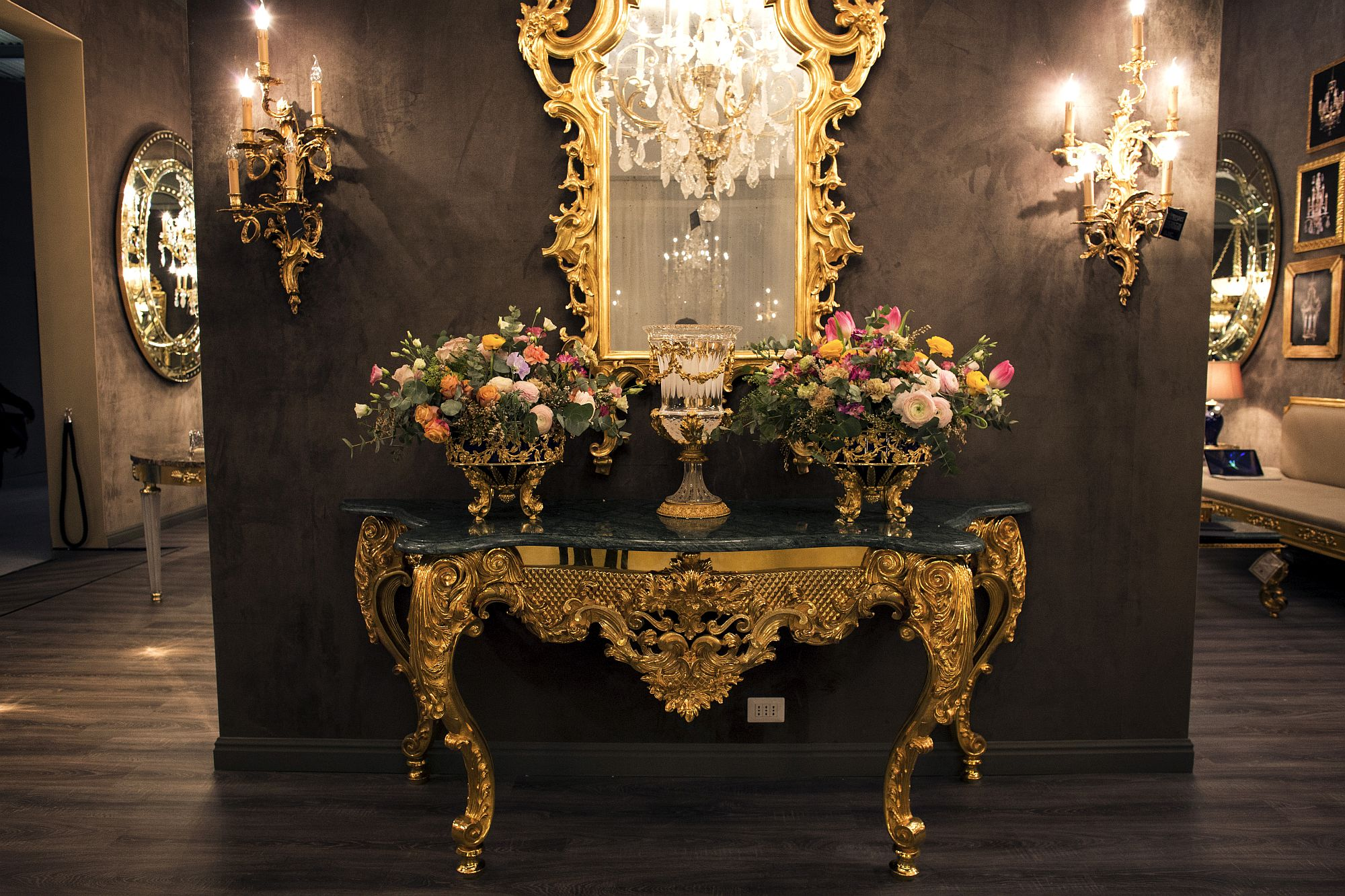 Ornate gold frame of the mirror brings back regal Victorian style!