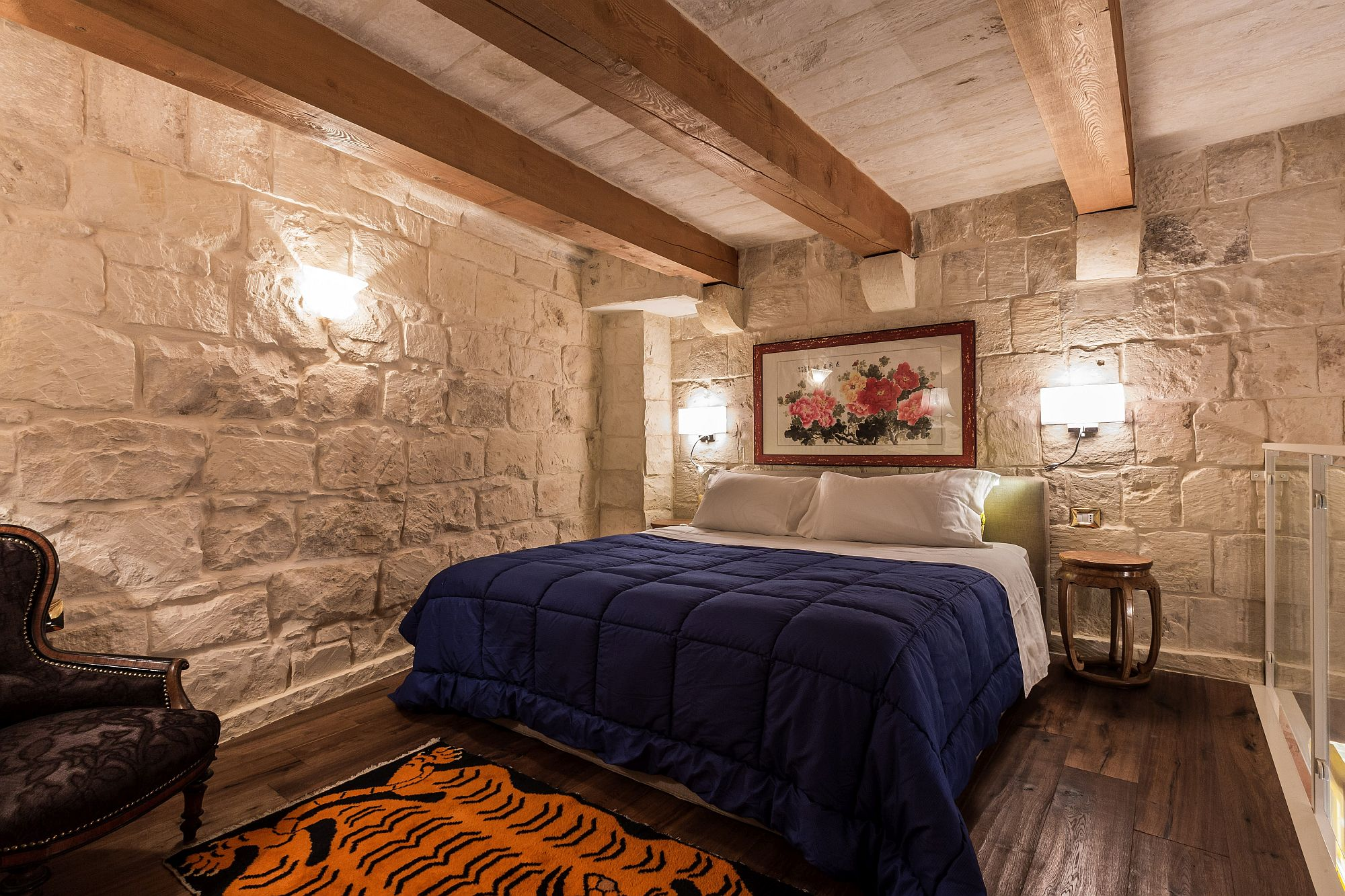 Private alcove with a comfy bed at the 50 square meter suite inside Locanda La Gelsomina