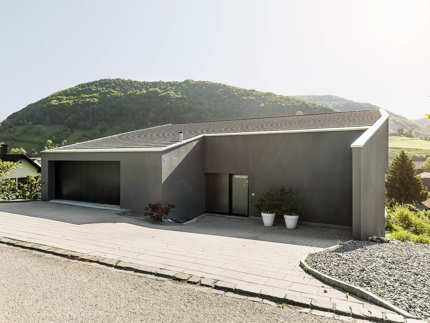 Private street facade of the Single Family House on a Slope