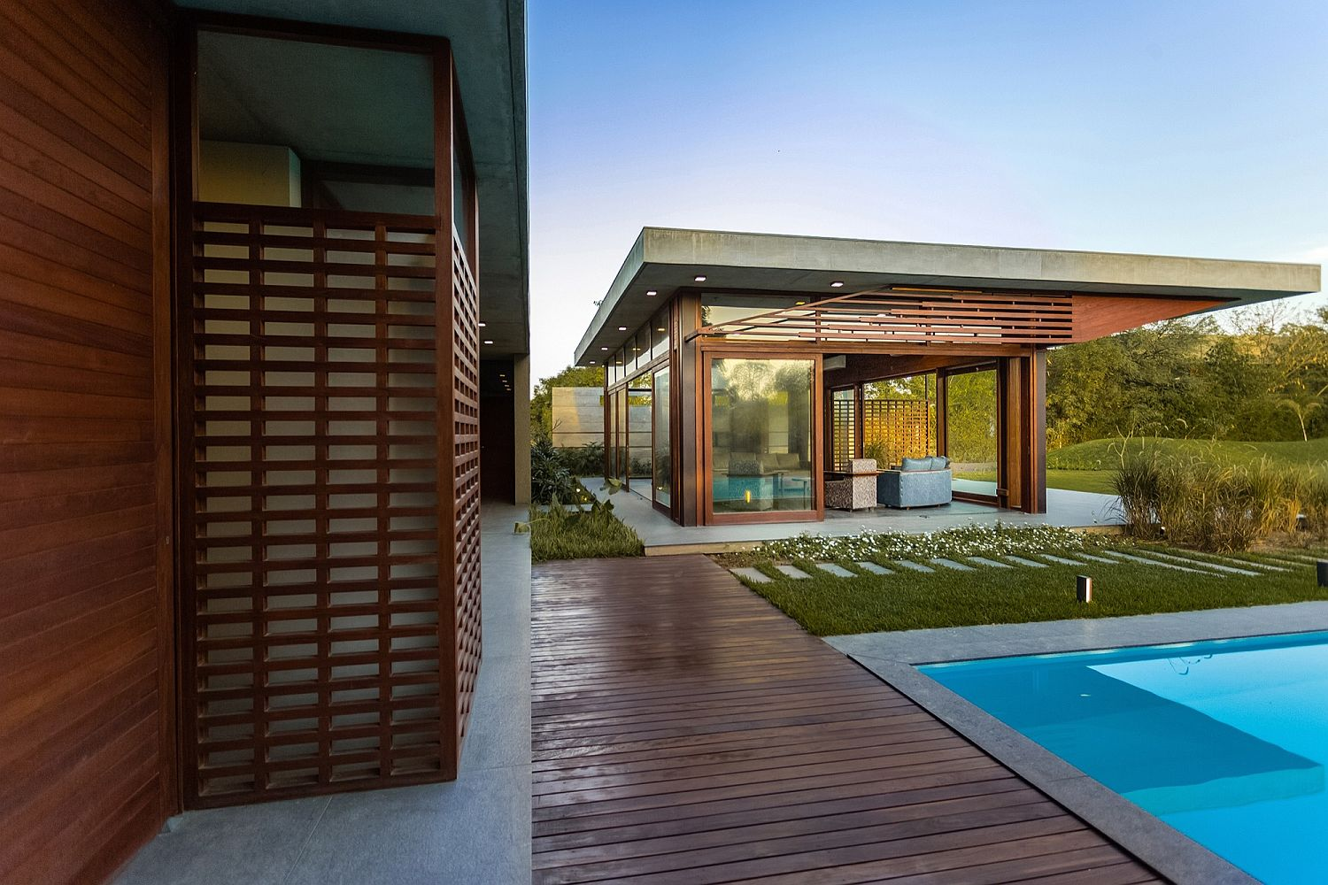 Private wing of the retreat flows into the deck and pool area outside