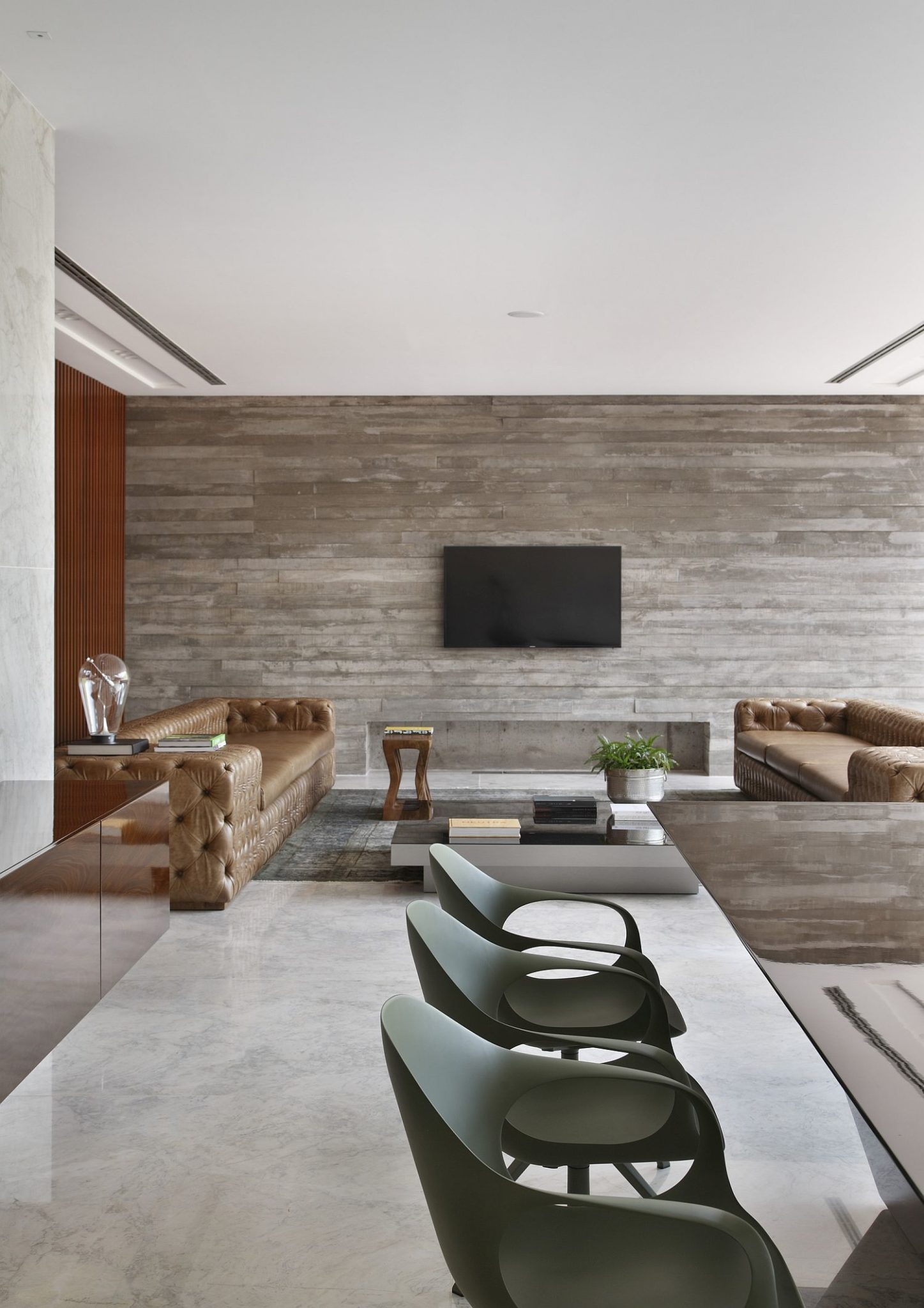 Reclaimed wood and concrete create an elegant living area