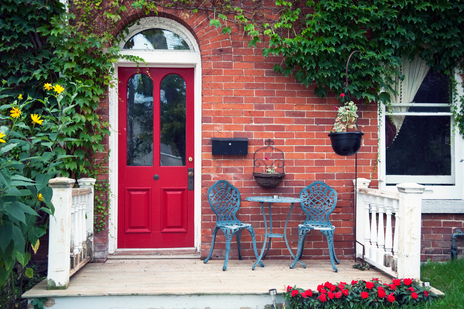 Red front door on brick house - Noticeable And Vibrant