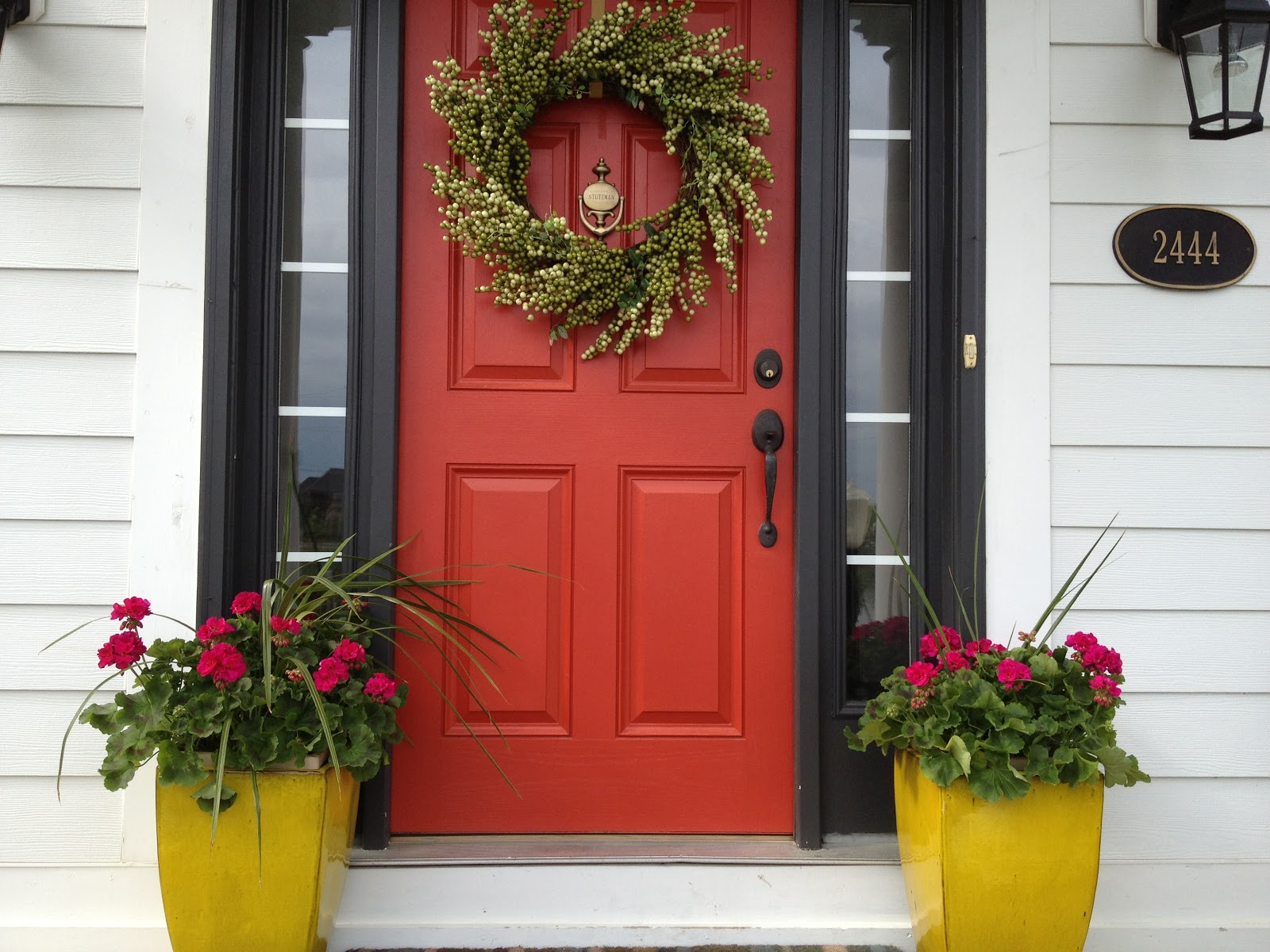 Creating a charming entryway with red front doors Gray front door meaning