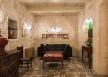 Relaxing-living-room-with-stone-walls-inside-the-second-suite-of-Locanda-La-Gelsomina-217x155