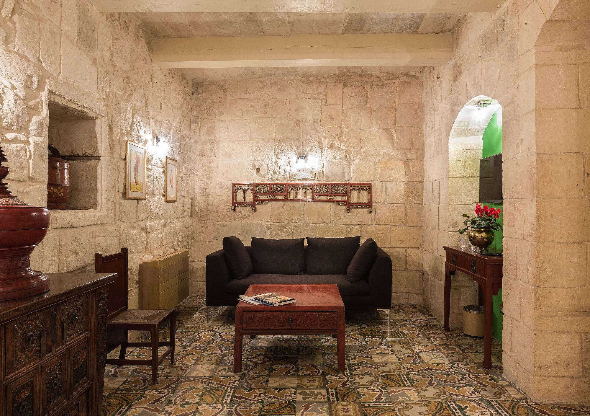 Relaxing living room with stone walls inside the second suite of Locanda La Gelsomina