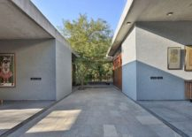 Rough-brown-kotah-stone-used-to-shape-the-interior-and-courtyards-around-the-house-217x155