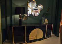 Series-of-round-mirrors-coupled-with-a-classic-console-in-the-entryway-217x155