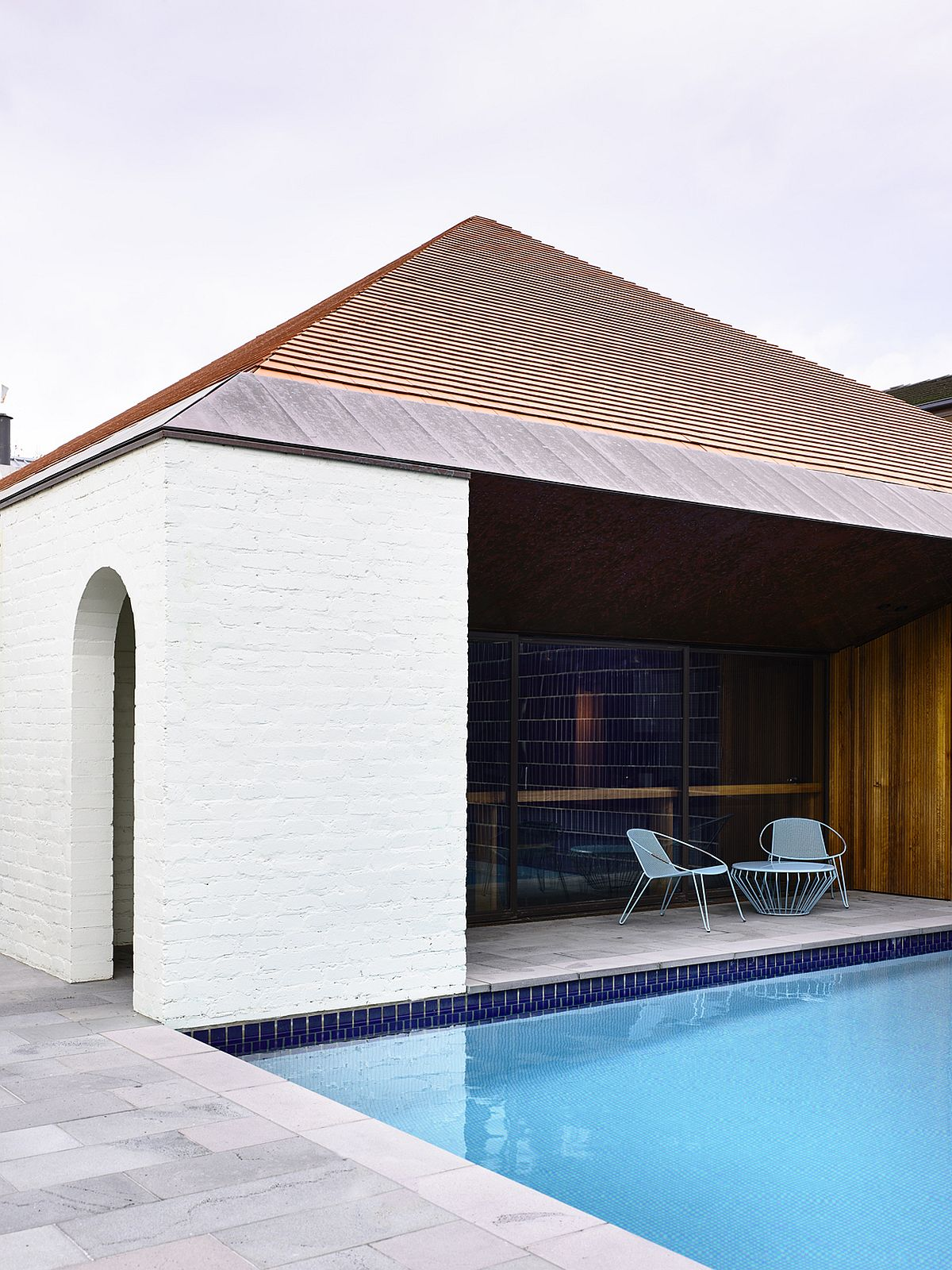 Shaded-outdoor-patio-next-to-the-pool