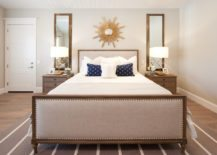 Shiny-sunburst-mirror-in-a-beige-bedroom-217x155