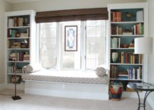 Simplistic-window-seat-balances-the-space-between-bookcases-217x155