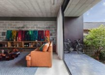 Sliding-glass-doors-and-drapes-delineate-the-interior-from-the-outdoor-deck-217x155
