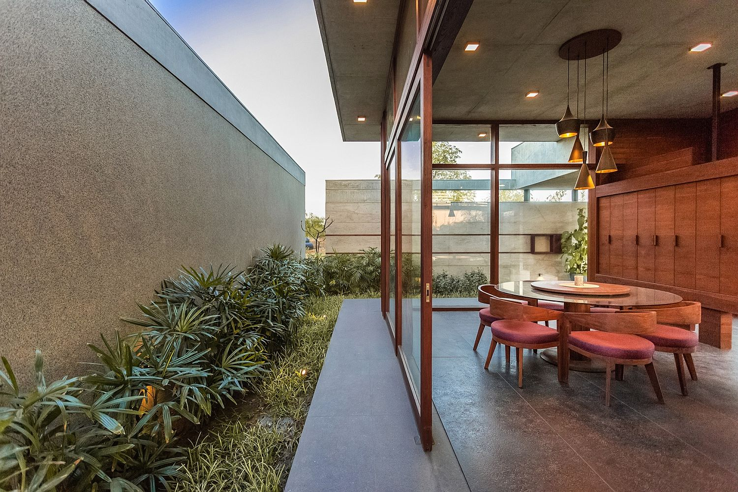 Sliding glass doors connect the dining area with the outdoors
