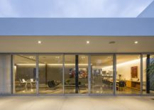 Sliding-glass-doors-connect-the-interior-with-the-pool-space-outside-217x155