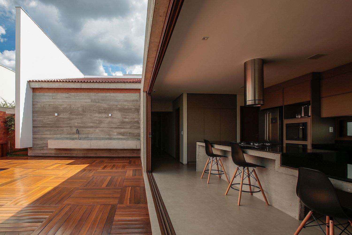 Sliding-glass-doors-connect-the-long-kitchen-with-the-wooden-deck-outside