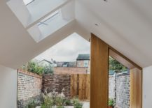 Small-rear-garden-along-with-the-kitchen-and-dining-of-the-contemporary-extension-217x155